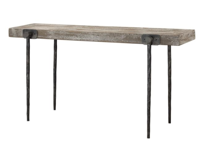 Rustic industrial styling displayed in the tapered cast iron legs featuring a hand chiseled texture. Accented by four oversize iron knobs holding a recycled pine tabletop finished in a sandblasted antique white over natural wood. Solid wood will continue to move with temperature and humidity changes, which can result in small cracks and uneven surfaces, adding to its authenticity and character. Dimensions: 62 W X 32 H X 18 D (in) Weight: 66
